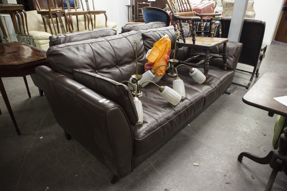 Lot 43 - A CHOCOLATE BROWN LEATHER THREE PIECE SUITE, COMPRISING; A FOUR SEATER SOFA AND TWO MATCHING