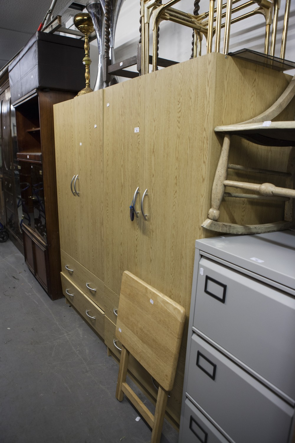 Lot 42 - A PAIR OF LIGHT OAK EFFECT TWO DOOR WARDROBES, EACH WITH A DRAWER BELOW