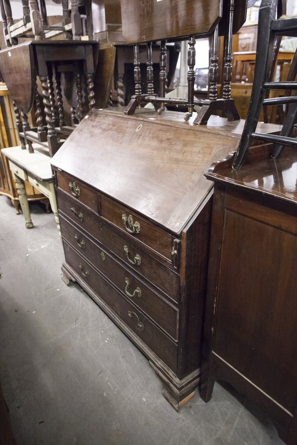 Lot 6 - A LARGE LATE EIGHTEENTH CENTURY MAHOGANY BUREAU WITH FITTED INTERIOR OVER TWO SHORT AND THREE LONG