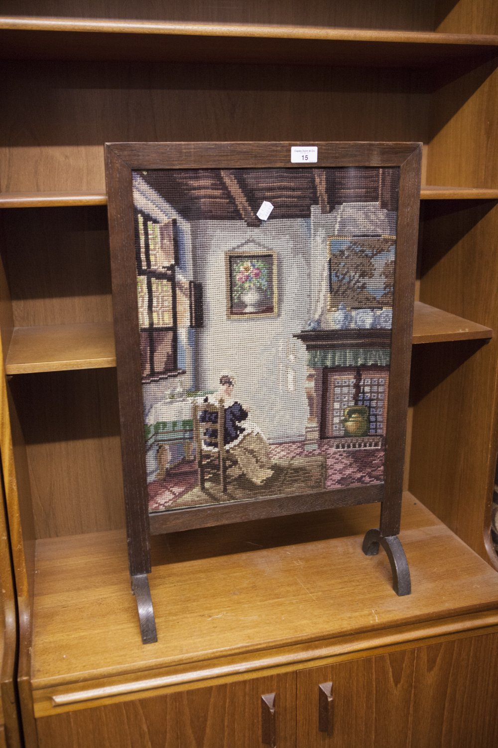 Lot 15 - A VICTORIAN FIRE SCREEN, OAK FRAME WITH NEEDLEWORK SCENE OF A SEATED WOMAN READING