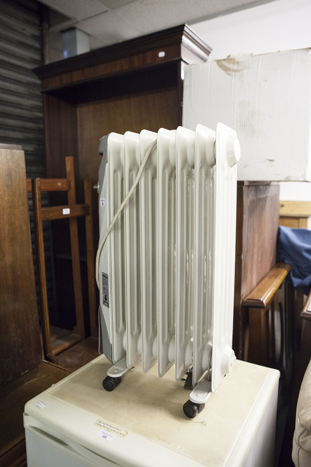 Lot 38 - A DIMPLEX ELECTRIC COLUMN OIL FILLED RADIATOR