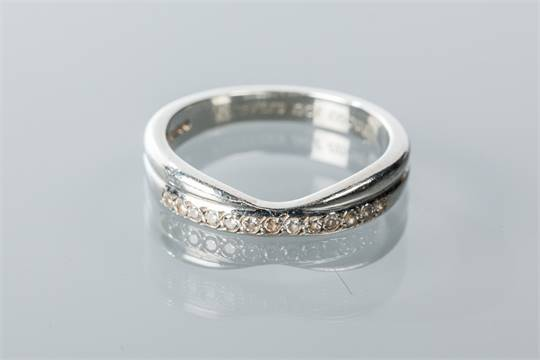 Diamond Set Wedding Band Shaped To Fit Around An Engagement Ring With A Row Of Brilliant Cut