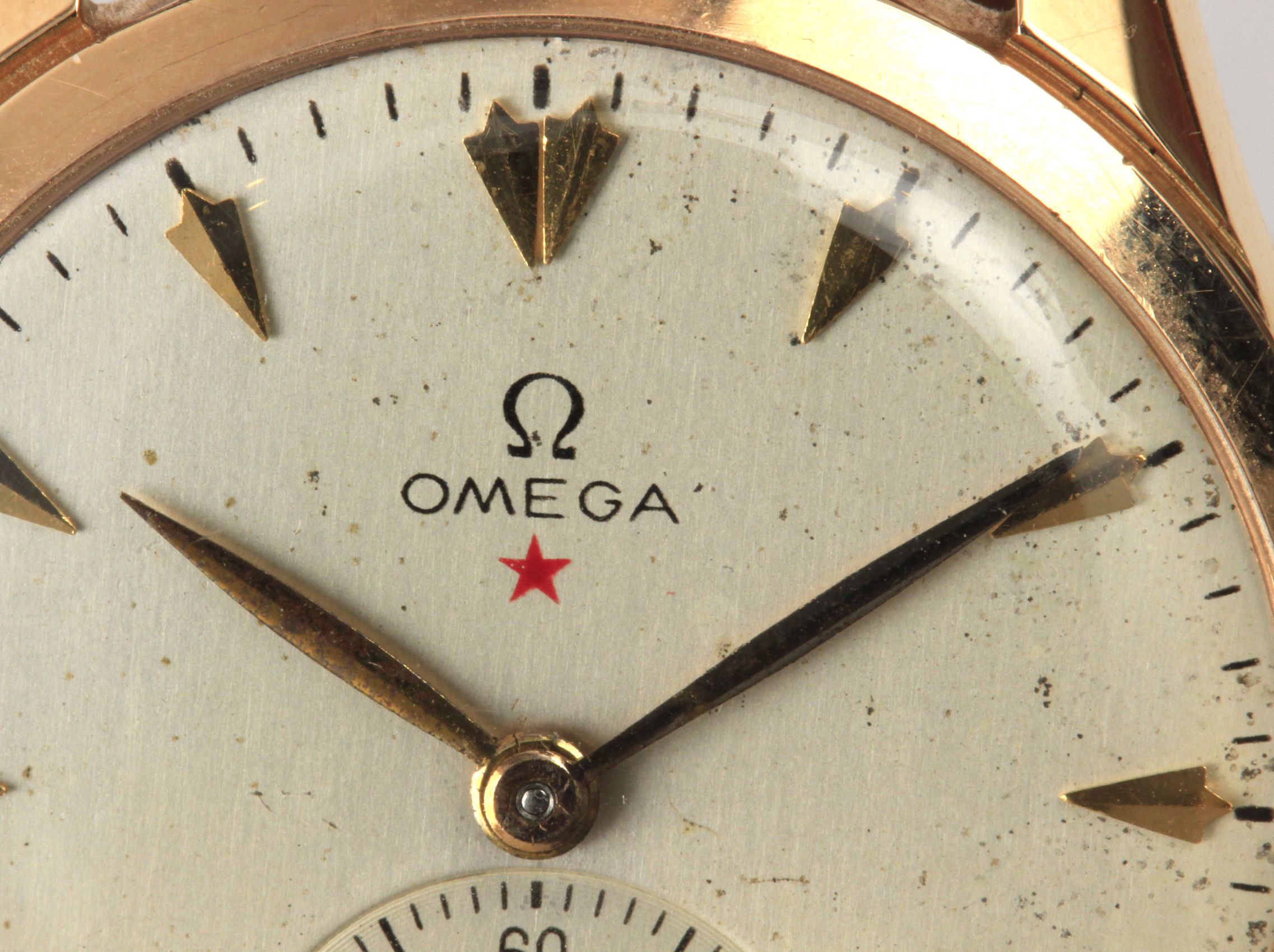 Lot 81 - Omega. A wrist watch circa 1950 in 18 k. yellow gold