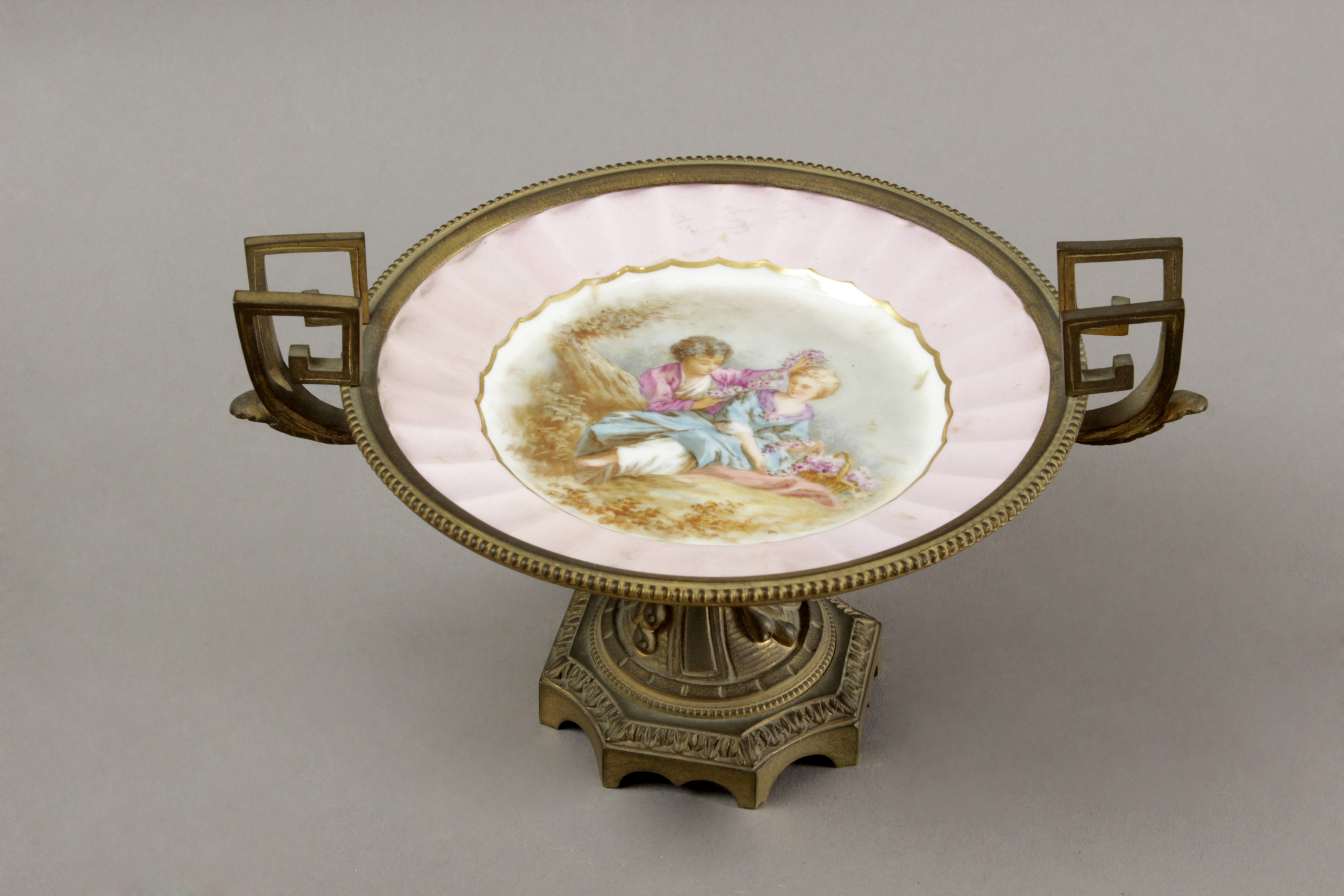 A late 19th century French gilt bronze centrepiece with a Sévres porcelain plate