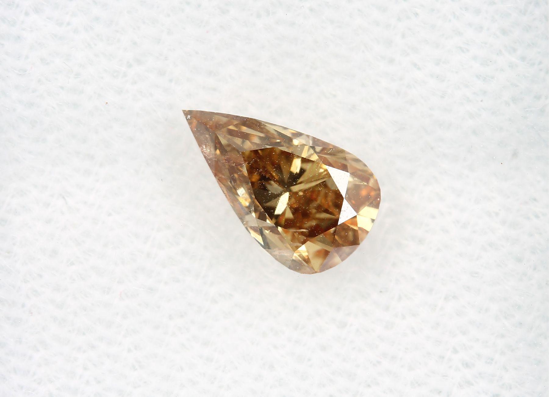 Loser Diamant, 1.01 ct Natural fancy deep brown-yellow, tropfenf. facett., 8.57 x 5.02 x 3.9 mm, mit