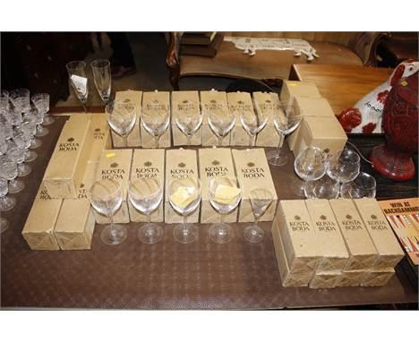 A quantity of Kosta Boda table glassware