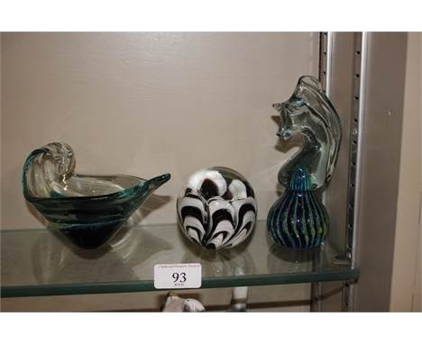 A Mdina glass seahorse; a similar heavy glass jug; and a paperweight