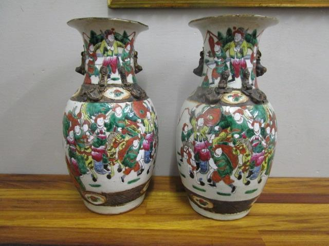 """Lot 22 - A pair of early 20th century Chinese porcelain vases decorated with various figures, 13 2/8"""" high"""