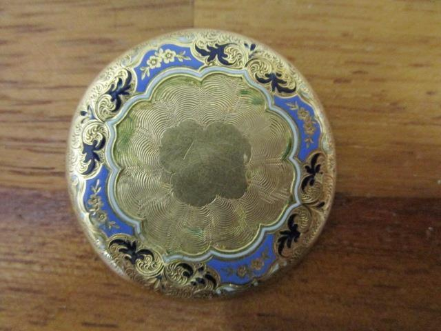 Lot 10 - An 18ct yellow gold and guilloche enamelled brooch with engraved, floral decoration, makers mark JLP
