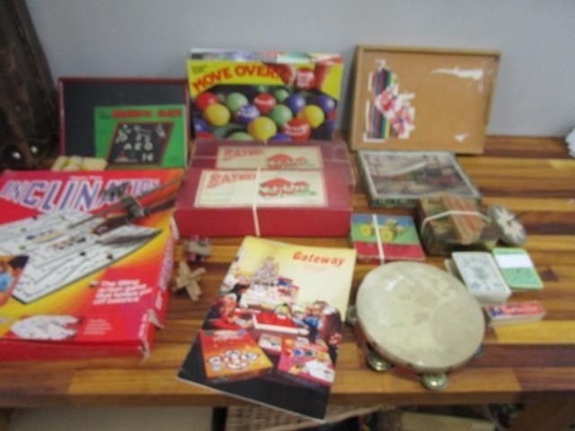 Lot 17 - A mixed lot of toys and games to include Baulp sets No 1c and No 2c, a Britains metal model Spitfire