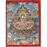 A MAGNIFICENT THANGKA OF GURU RINPOCHE IN ZANGDOK PALRI Distemper and gold paint on cloth, framed by