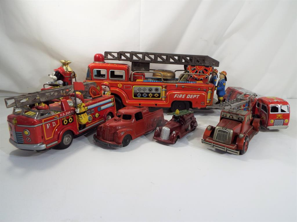 Lot 92 - Metalcraft, Timpo and others - five tin-plate fire engines, three friction powered plus two others,