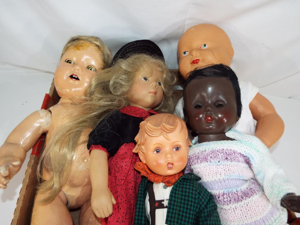 Lot 120 - Dolls - five vintage predominantly dressed dolls to include a bisque headed baby doll marked 50 to