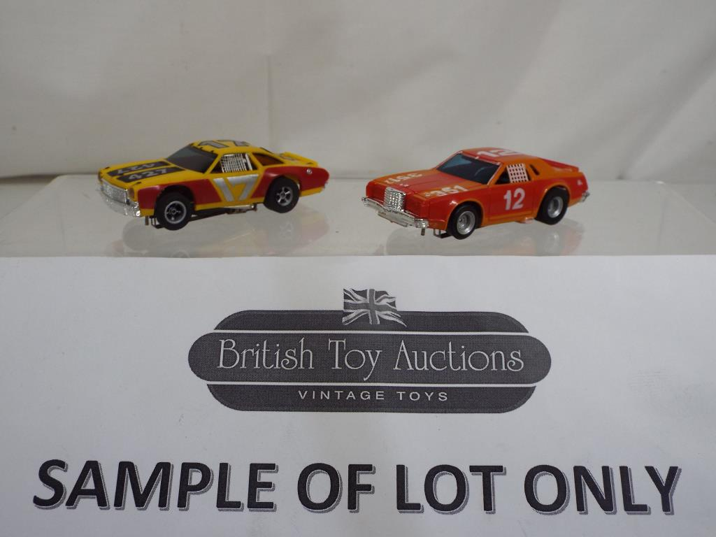 Lot 3 - Aurora - fourteen AFX slot cars with magna traction in original boxes comprising 1954 x 6 ,