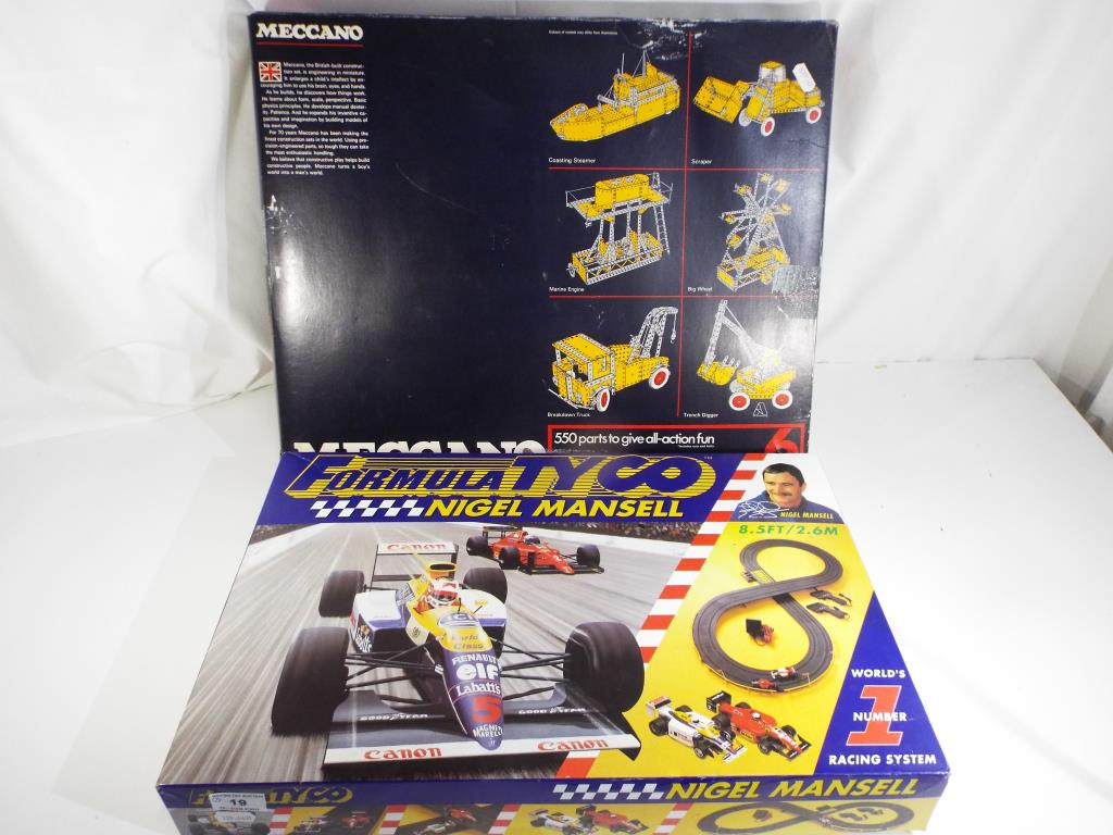 Lot 19 - Meccano and Tyco - two boxed sets comprising a family Tyco slot racing set and a Meccano #6 set,