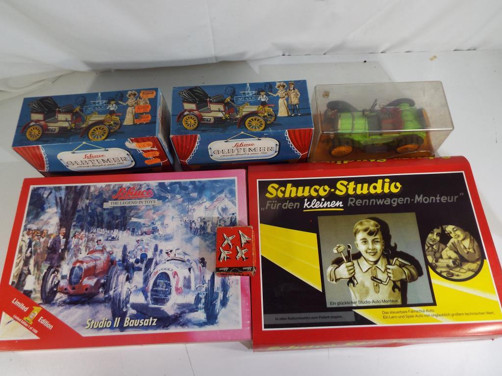 Lot 13 - Schuco -six boxed vehicles, includes two Schuco Studio metal racing car kits,