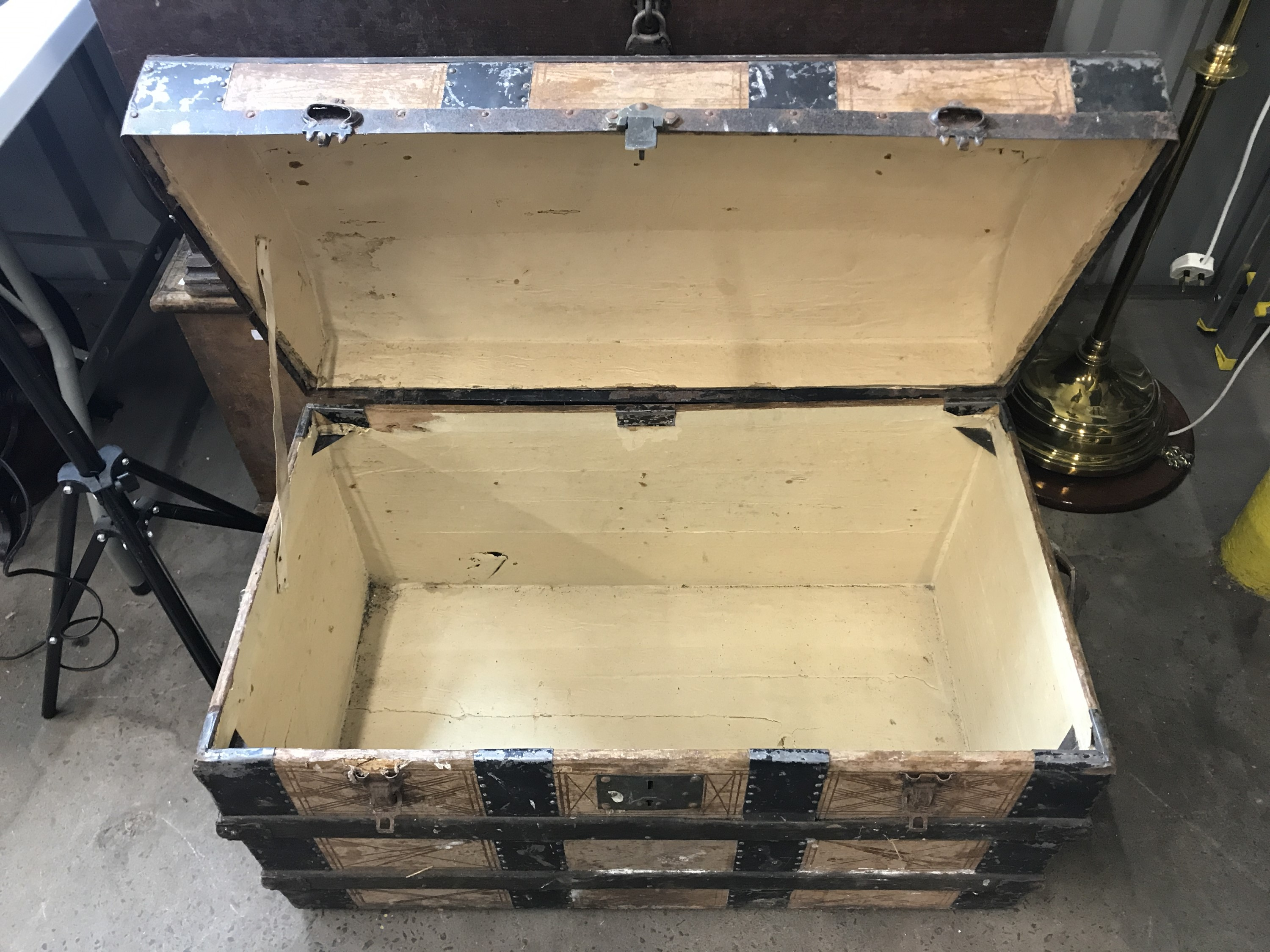 Lot 48 - A late 19th Century domed-top trunk with metal straps