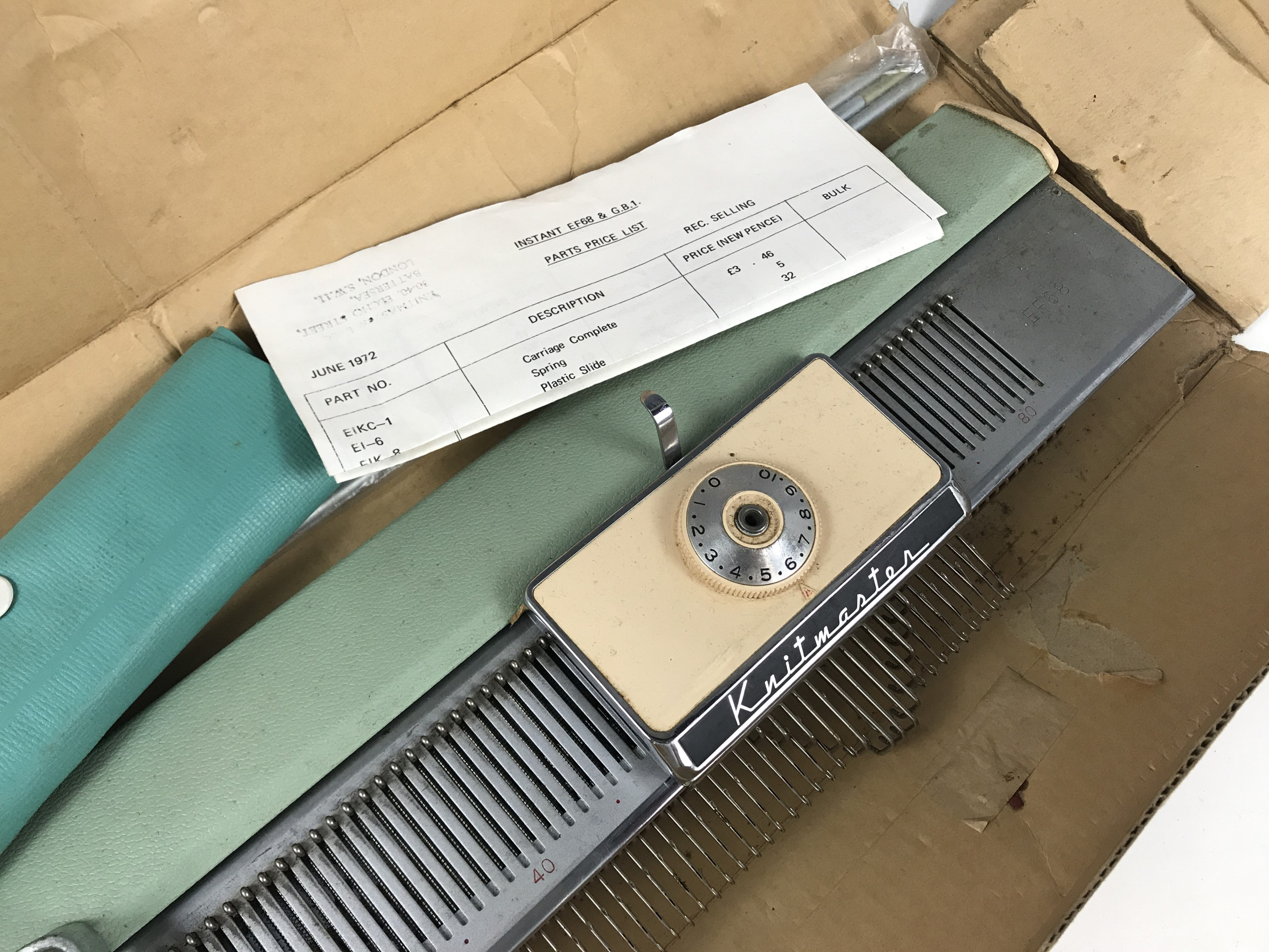 Lot 32 - A vintage Knitmaster knitting machine, in original carton together with price list