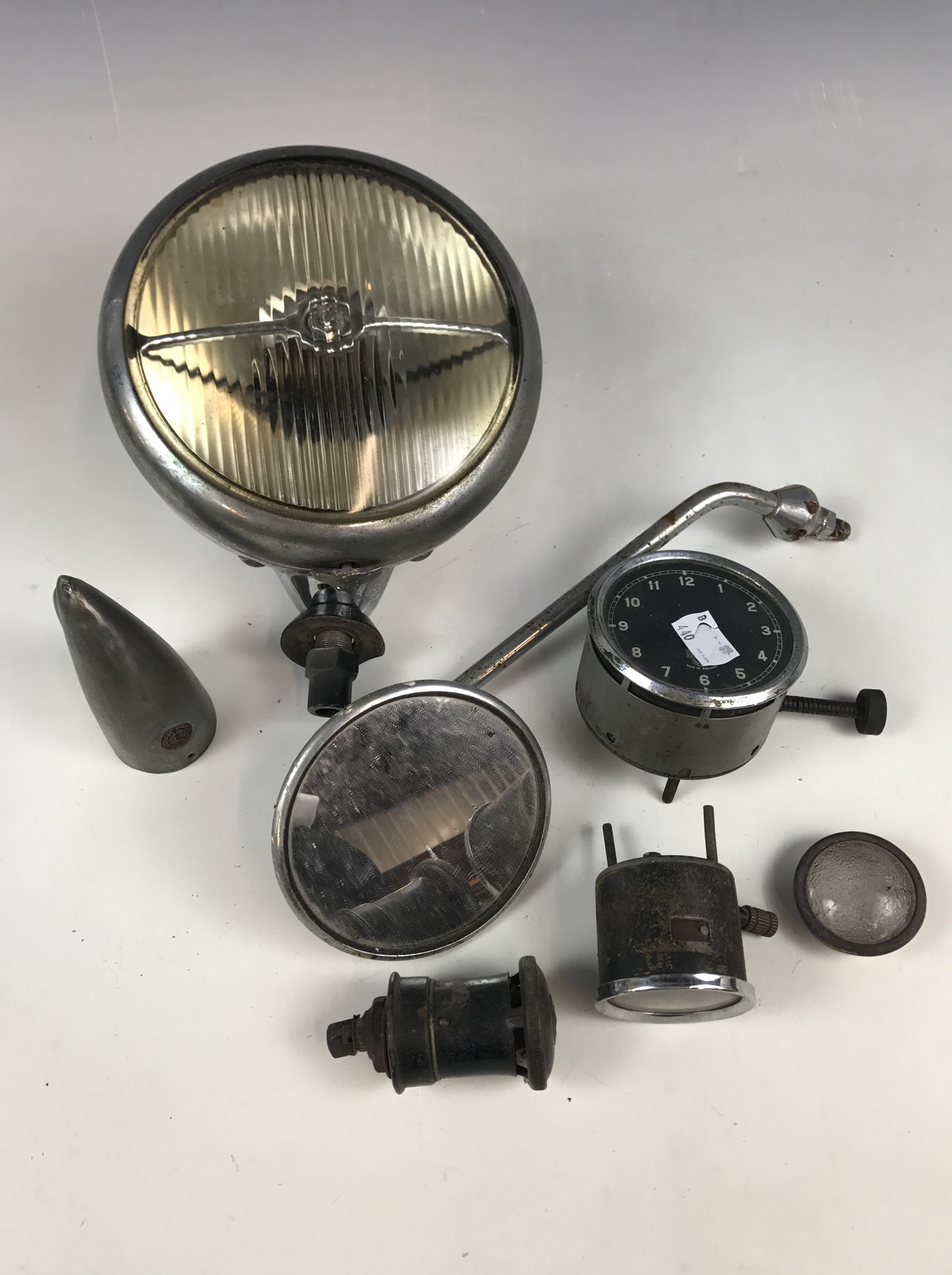 "Lot 33 - Vintage classic car parts including dial clocks and a ""King of the Road"" head / spot lamp etc"
