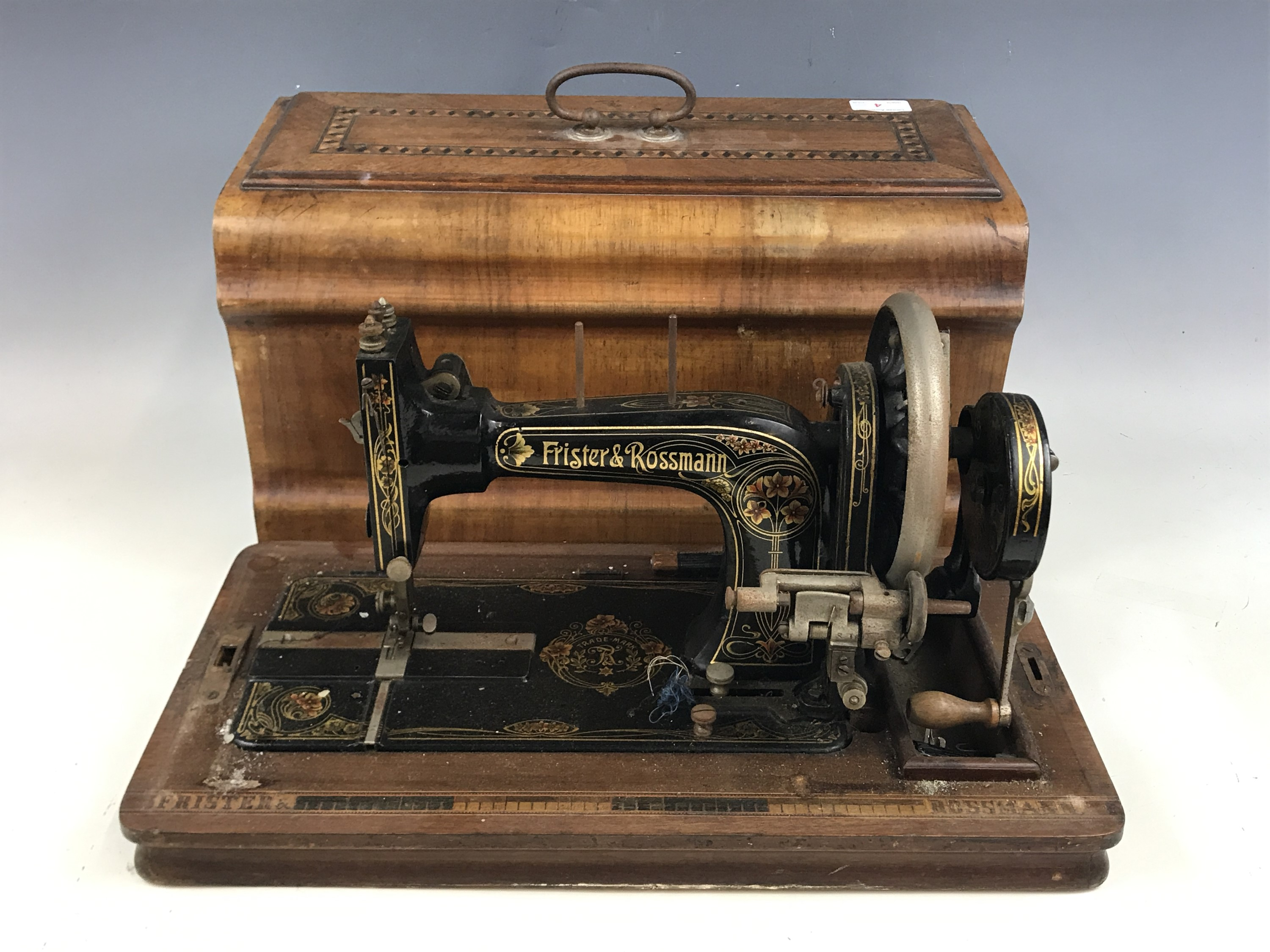 Lot 4 - A late 19th Century Frister and Rossmann sewing machine in a marquetry inlaid walnut case