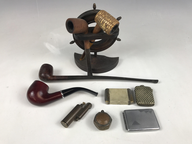 Lot 25 - Vintage smoking paraphernalia including a nautical pipe rack modelled as a ships wheel, pipes, vesta