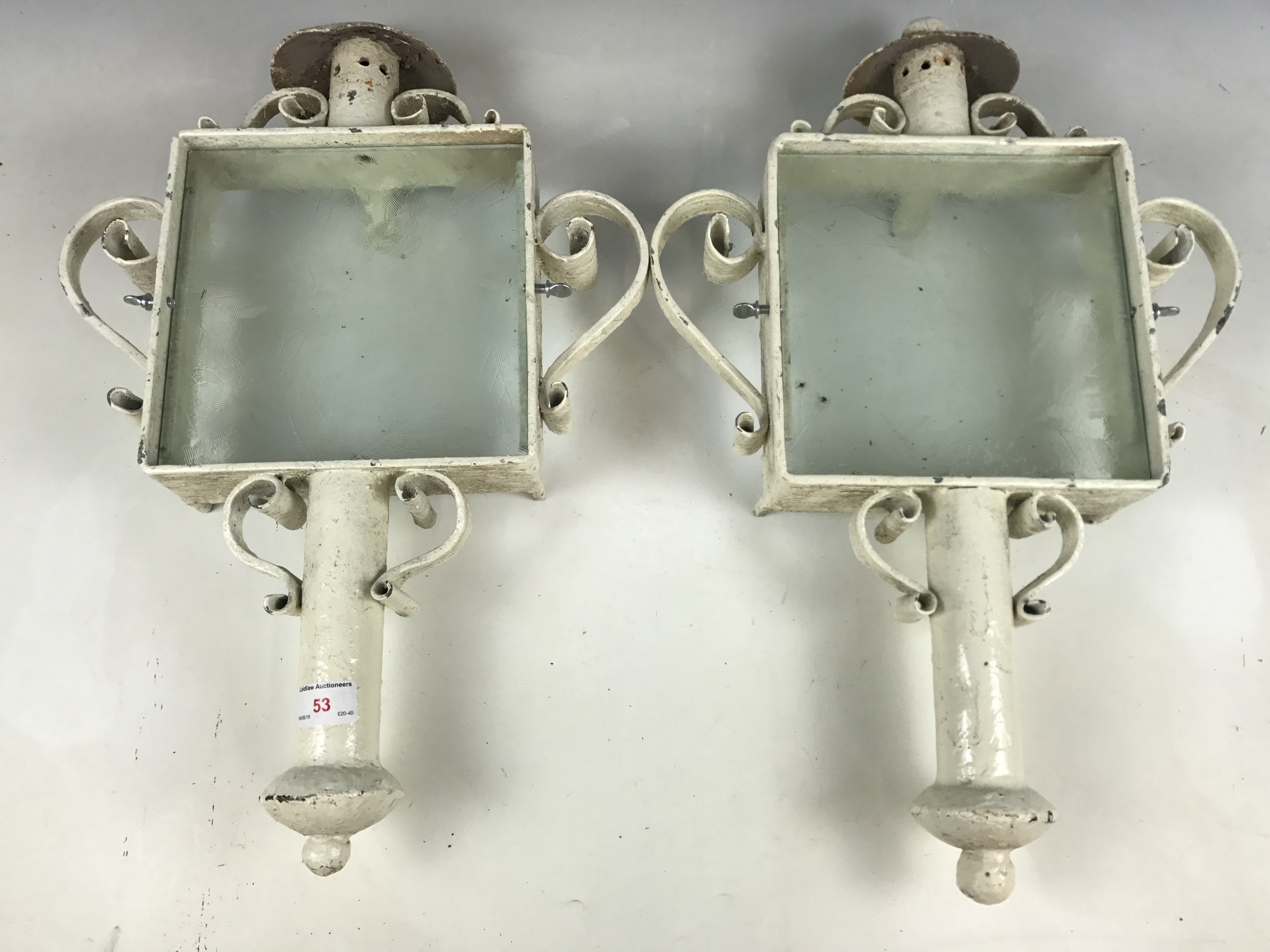 Lot 53 - Two wrought-iron and glass exterior light sconces