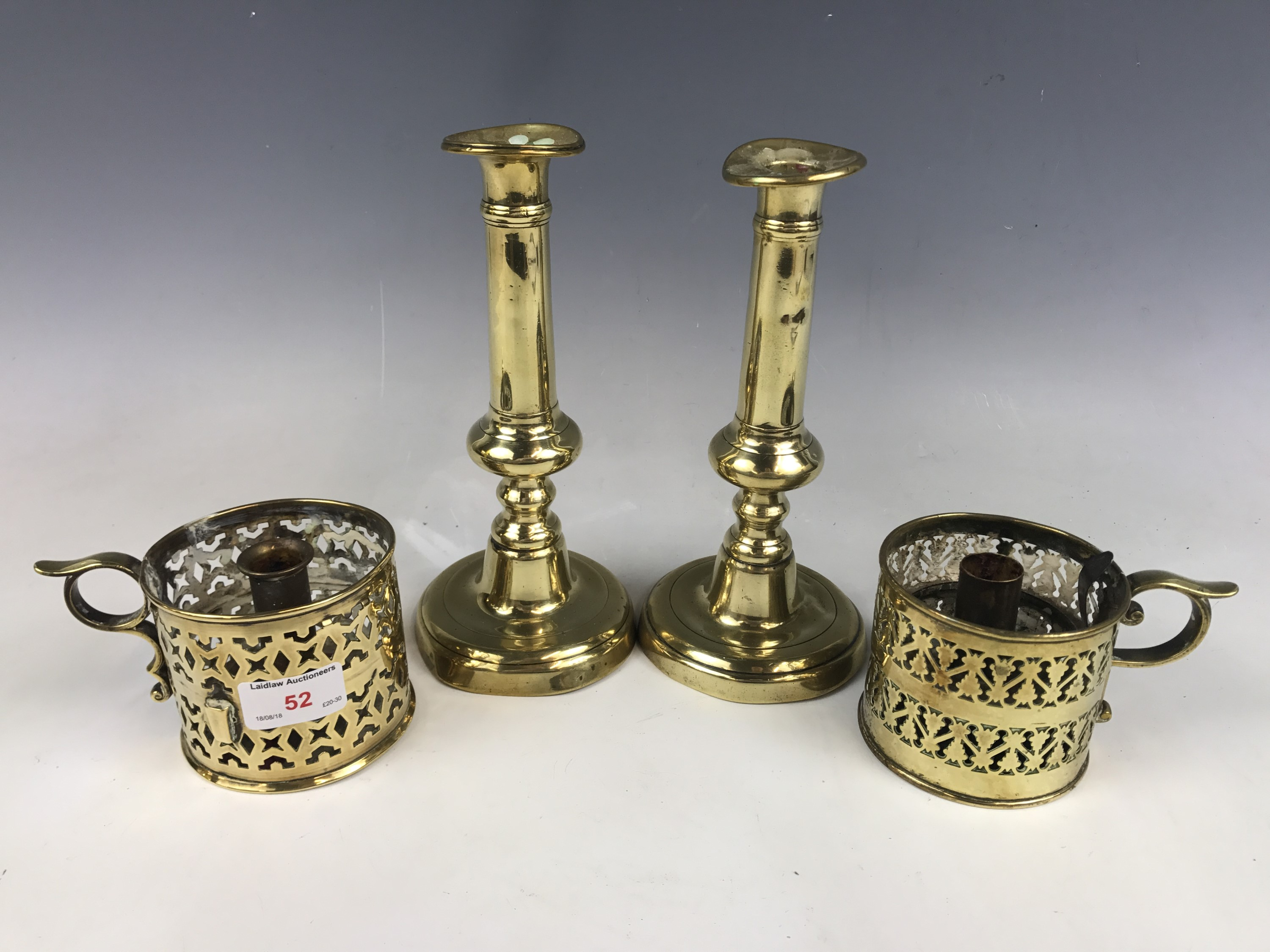 Lot 52 - A pair of early Victorian brass push-eject candlesticks together with a pair of early 19th Century