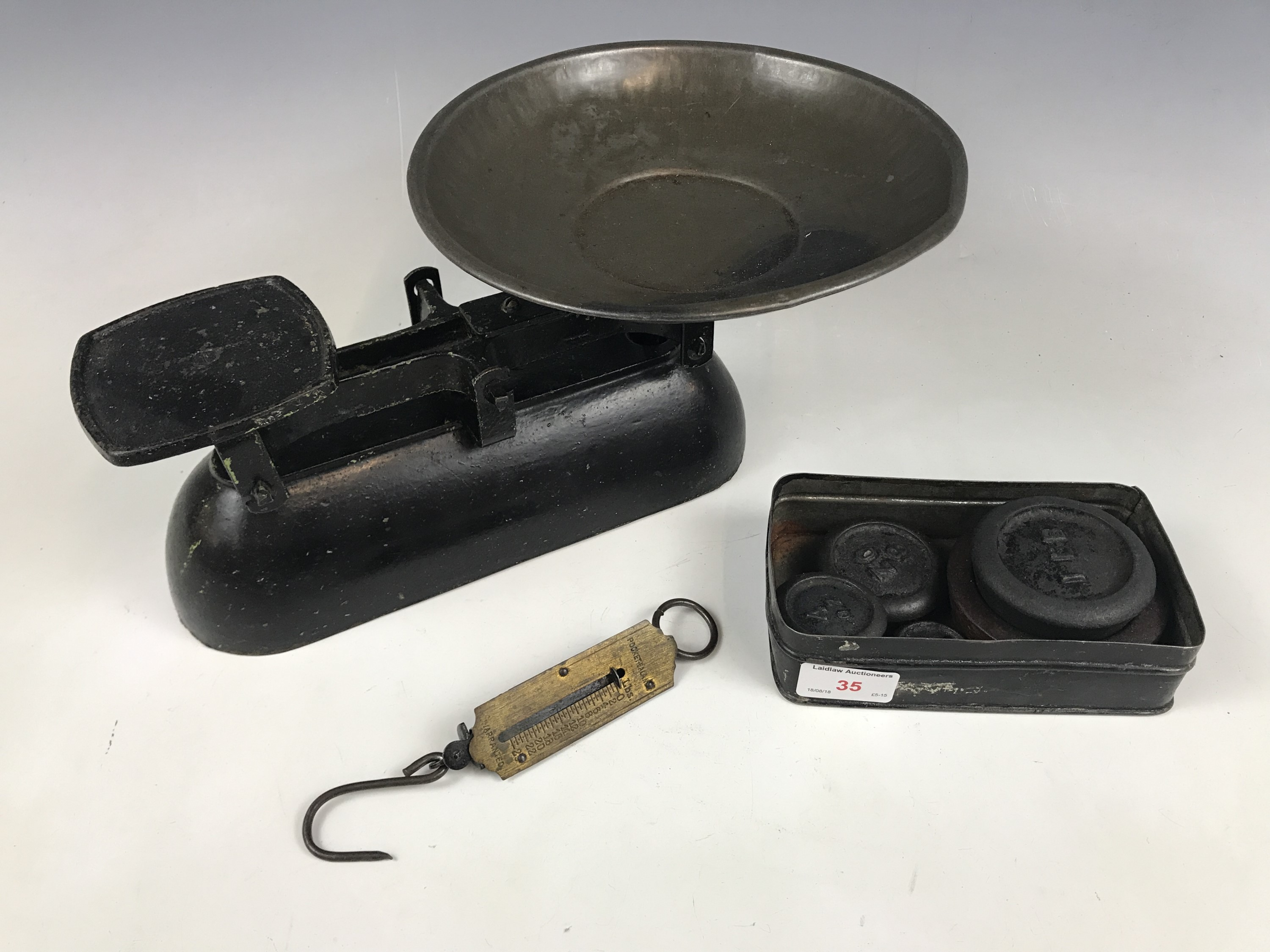 Lot 35 - A set of vintage kitchen scales and weights, together with a pocket spring-balance