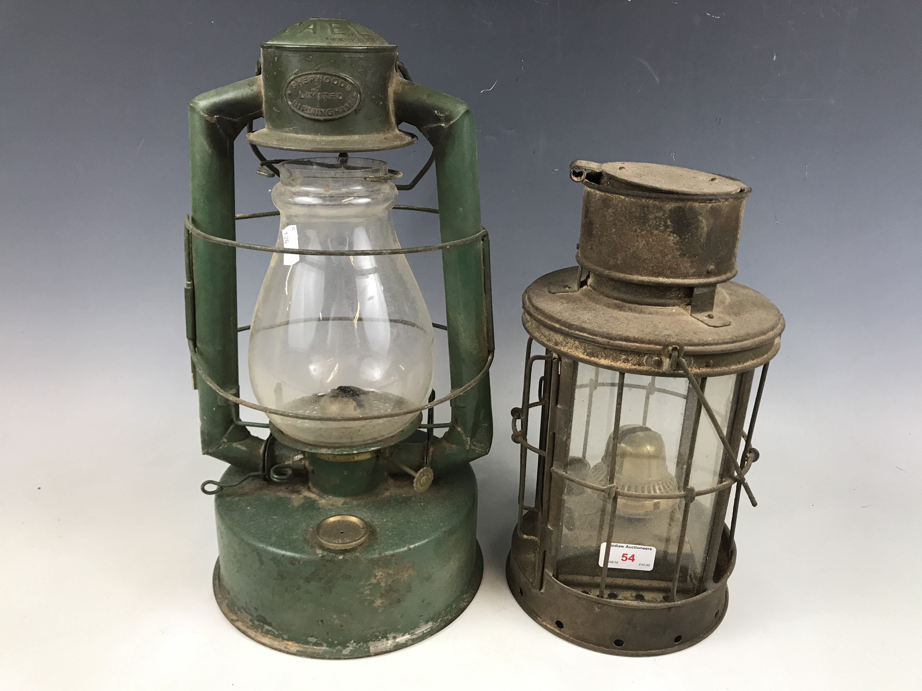 Lot 54 - A vintage Gael Brooder paraffin lamp together with one other