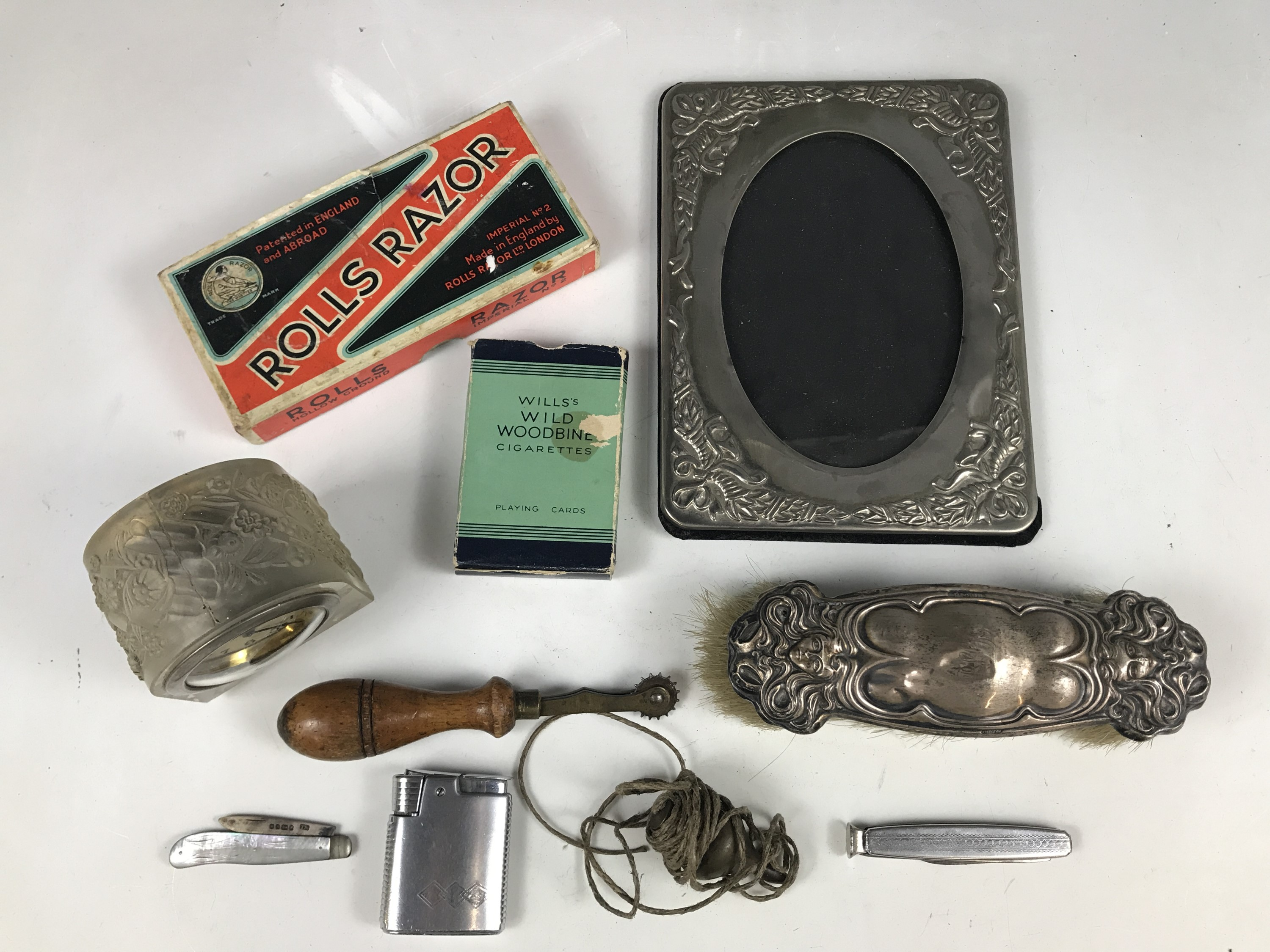Lot 21 - Sundry collectors' items including a silver fruit knife, a silver mounted clothes brush, a boxed