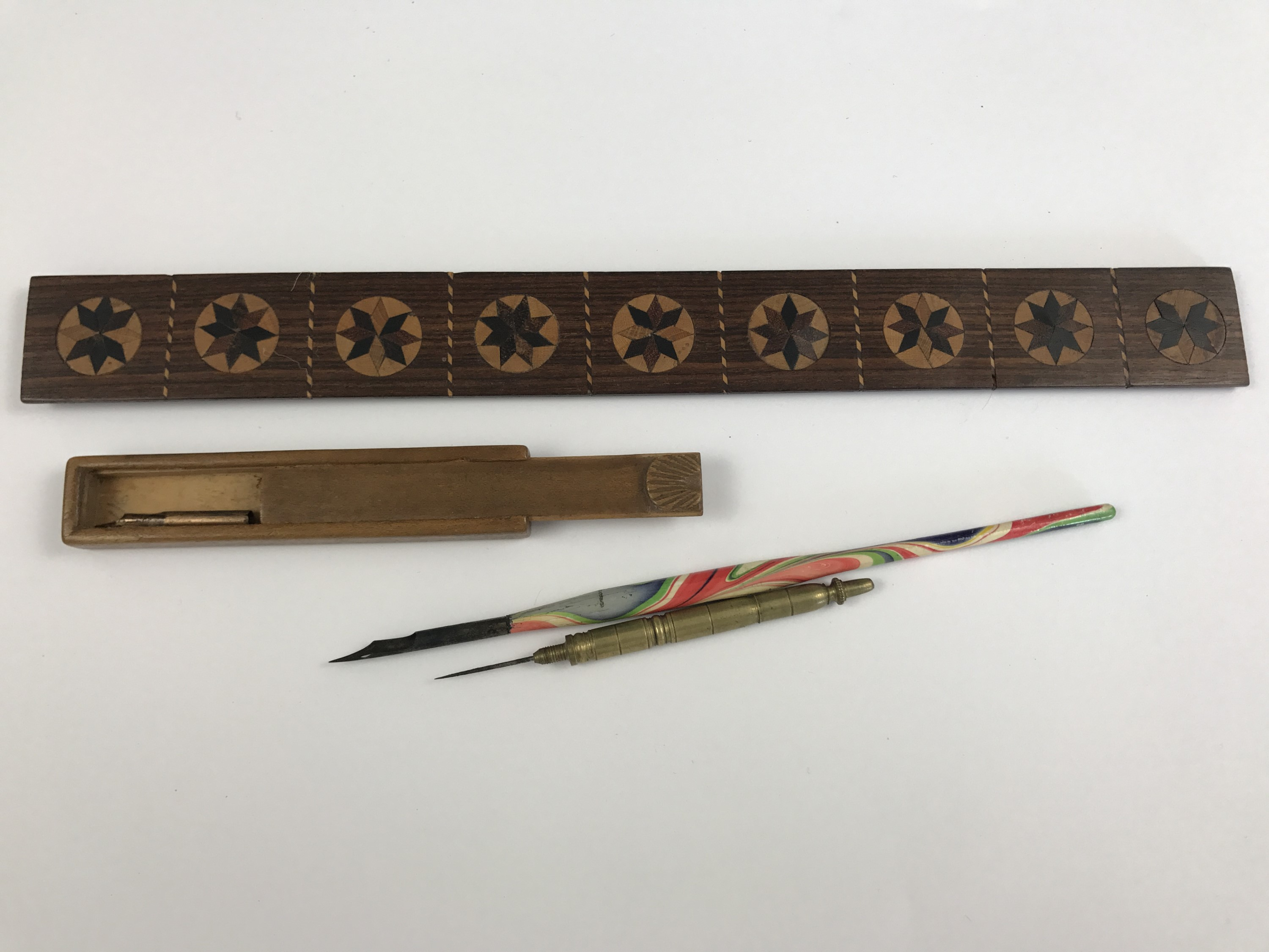 Lot 1 - 19th Century writing instruments including a marquetry inlaid straight edge, a Mauchline ware nib
