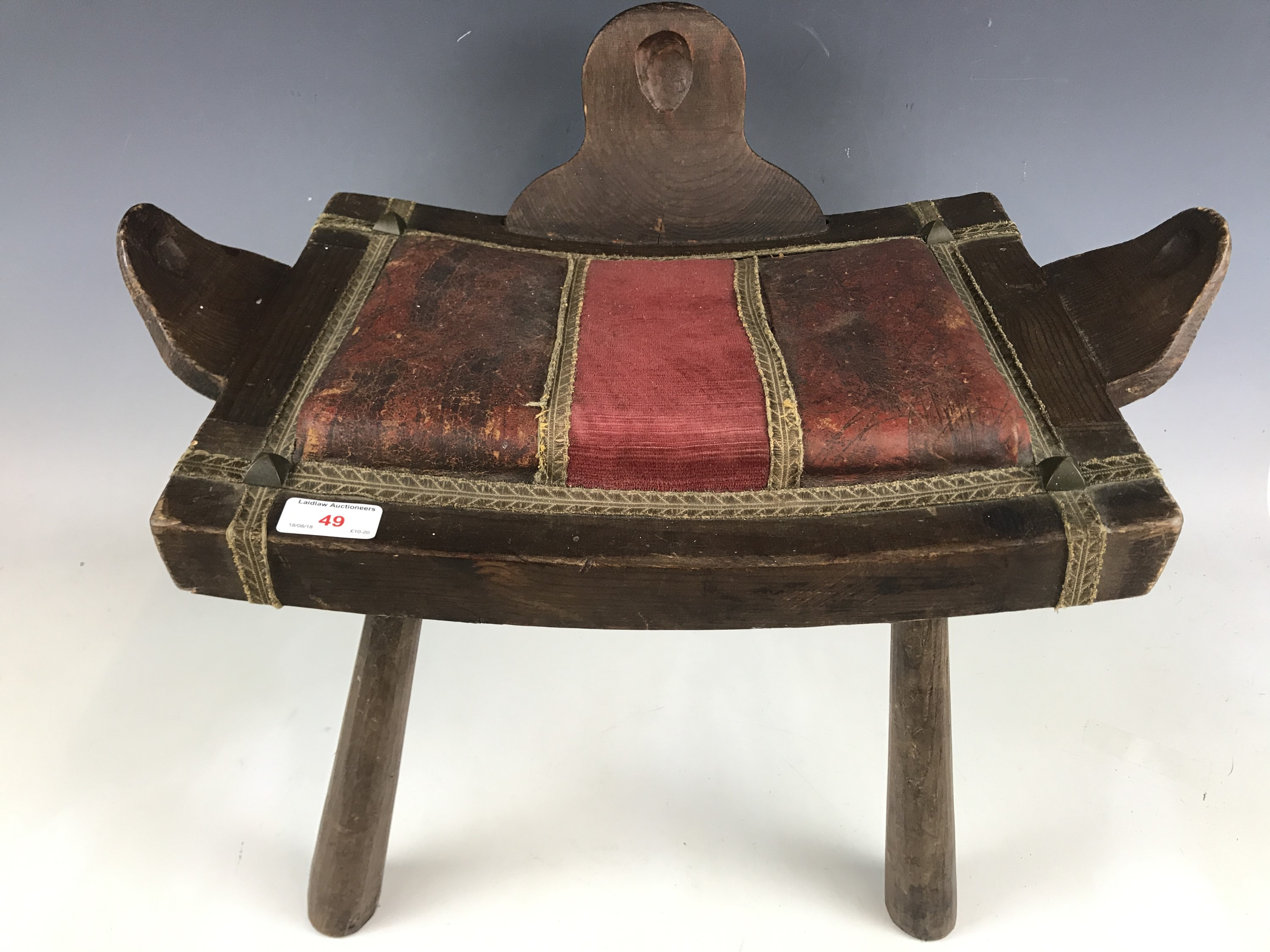 Lot 49 - A tribal stool