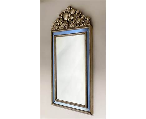 WALL MIRROR, Italian style silvered wood, rectangular with blue glass mirror plates and fruit and blossom crest, 103cm H x 53