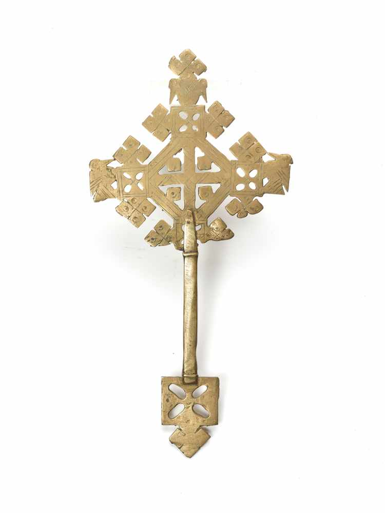 AN ETHIOPIAN PROCESSIONAL CROSS, CHASED AND OPENWORKED BRASS, 19TH CENTURYBrassEthiopia, late 19th