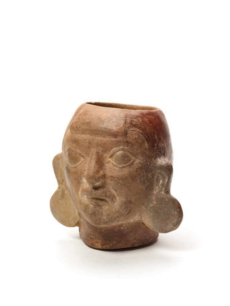 MUG IN THE SHAPE OF A HEAD – MOCHE CULTURE, PERU, C. 500 ADFired clayMoche culture, Peru, c. 500