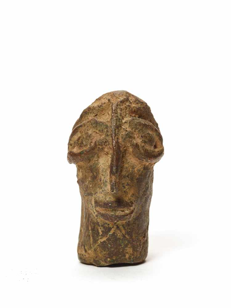 A CAST BRONZE BENIN STYLE HEADMassive casting with solid age patinaBenin, 20th century Dimensions: