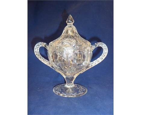 French Glass - a moulded colorless glass sugar box and cover, in the Rock Crystal style, the two handled boat form body and d