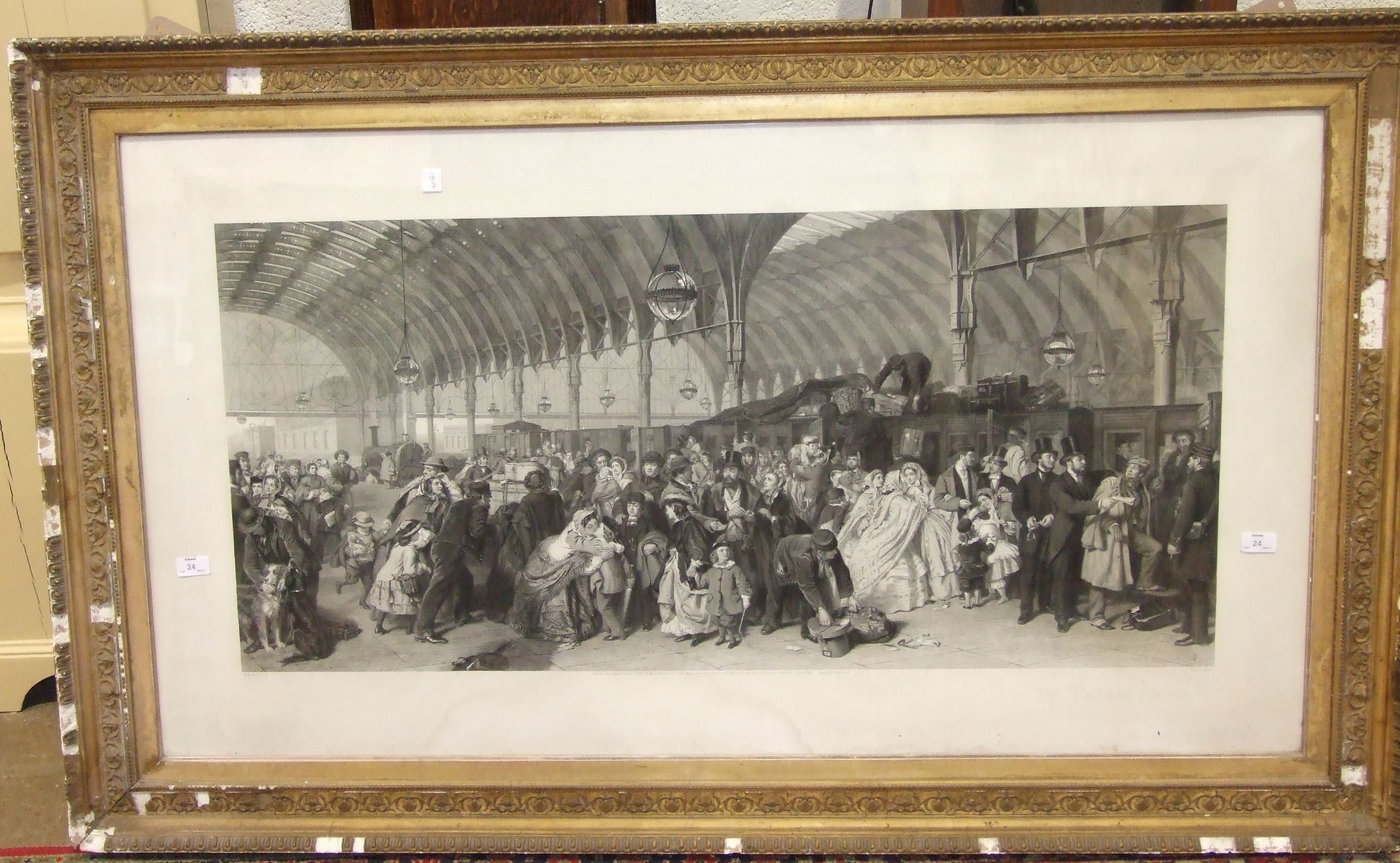 "Lot 24 - After W P Frith RA ""The Railway Station"", framed black and white engraving, 72 x 131cm, published"