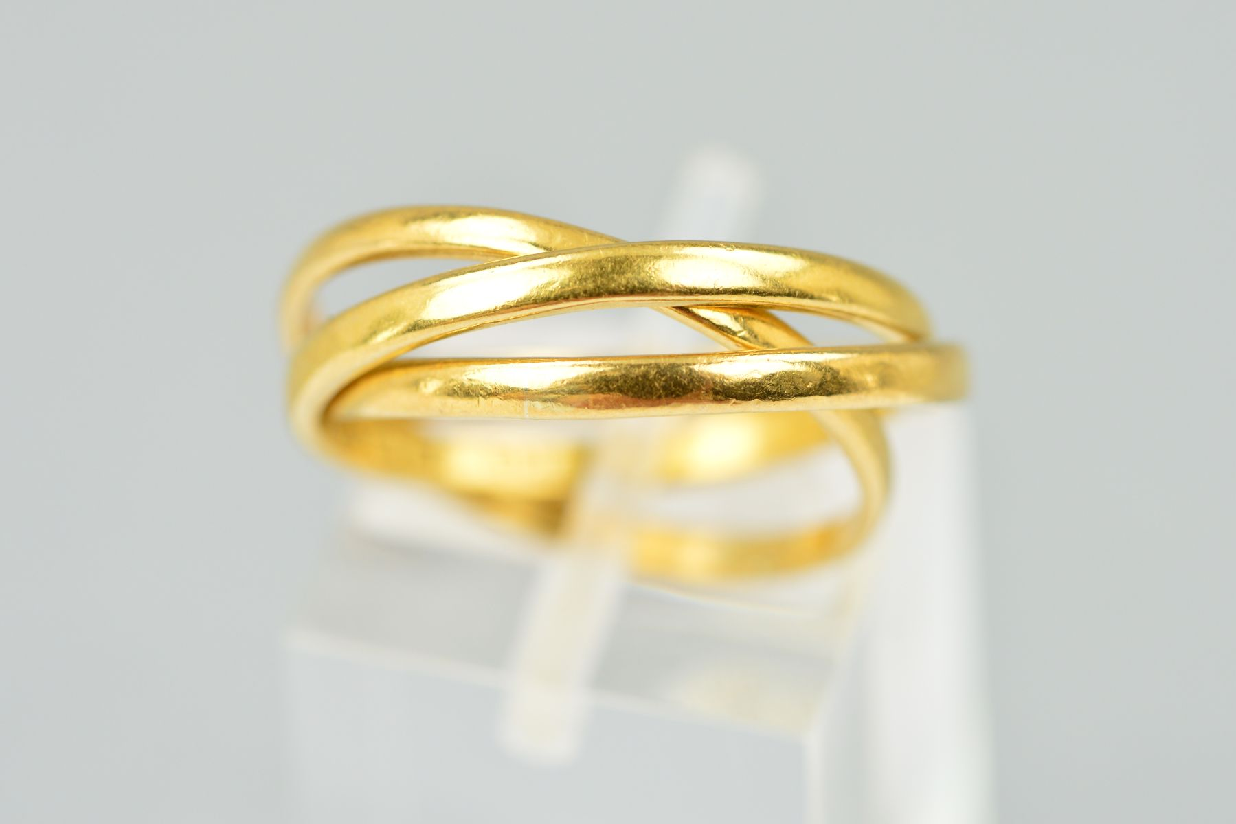 Lot 36 - A 22CT PLAIN GOLD RUSSIAN WEDDING RING, plain polished, each band measuring approximately 2.04mm