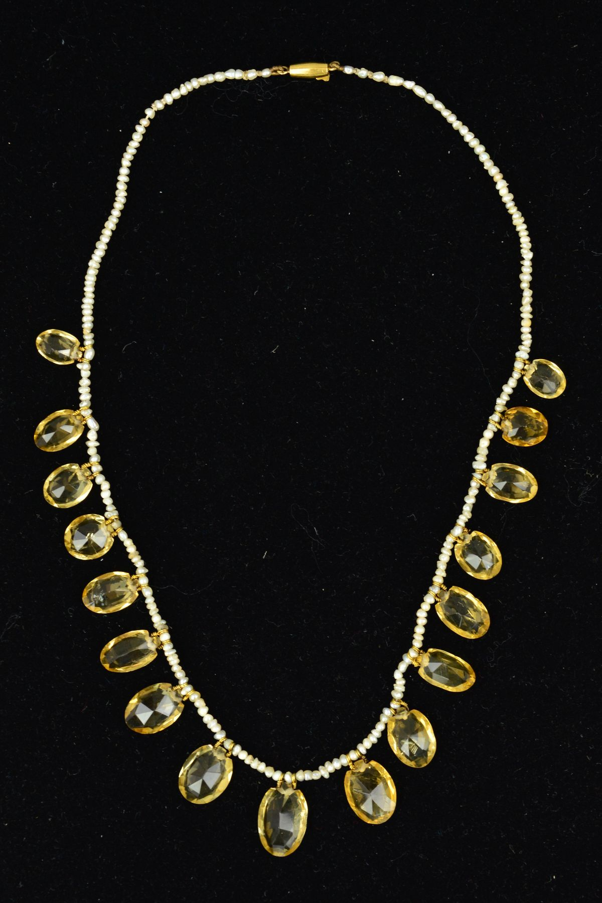 Lot 59 - A SEED PEARL AND CITRINE GRADUATED NECKLET, comprised of oval mixed cut citrines graduating in