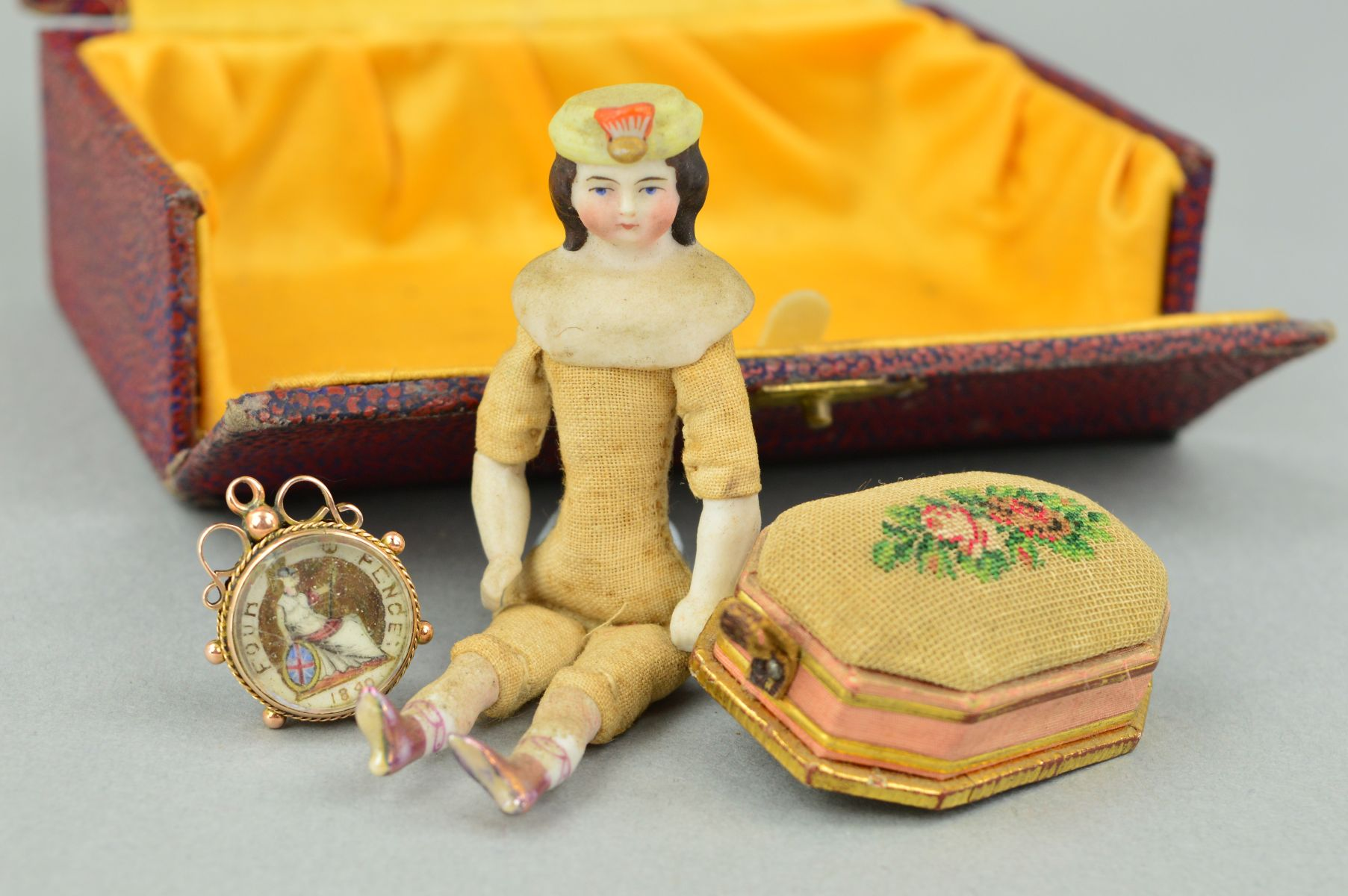 Lot 23 - THREE VICTORIAN ITEMS to include a mounted coin in a 9ct gold mount with scrolling, beaded and