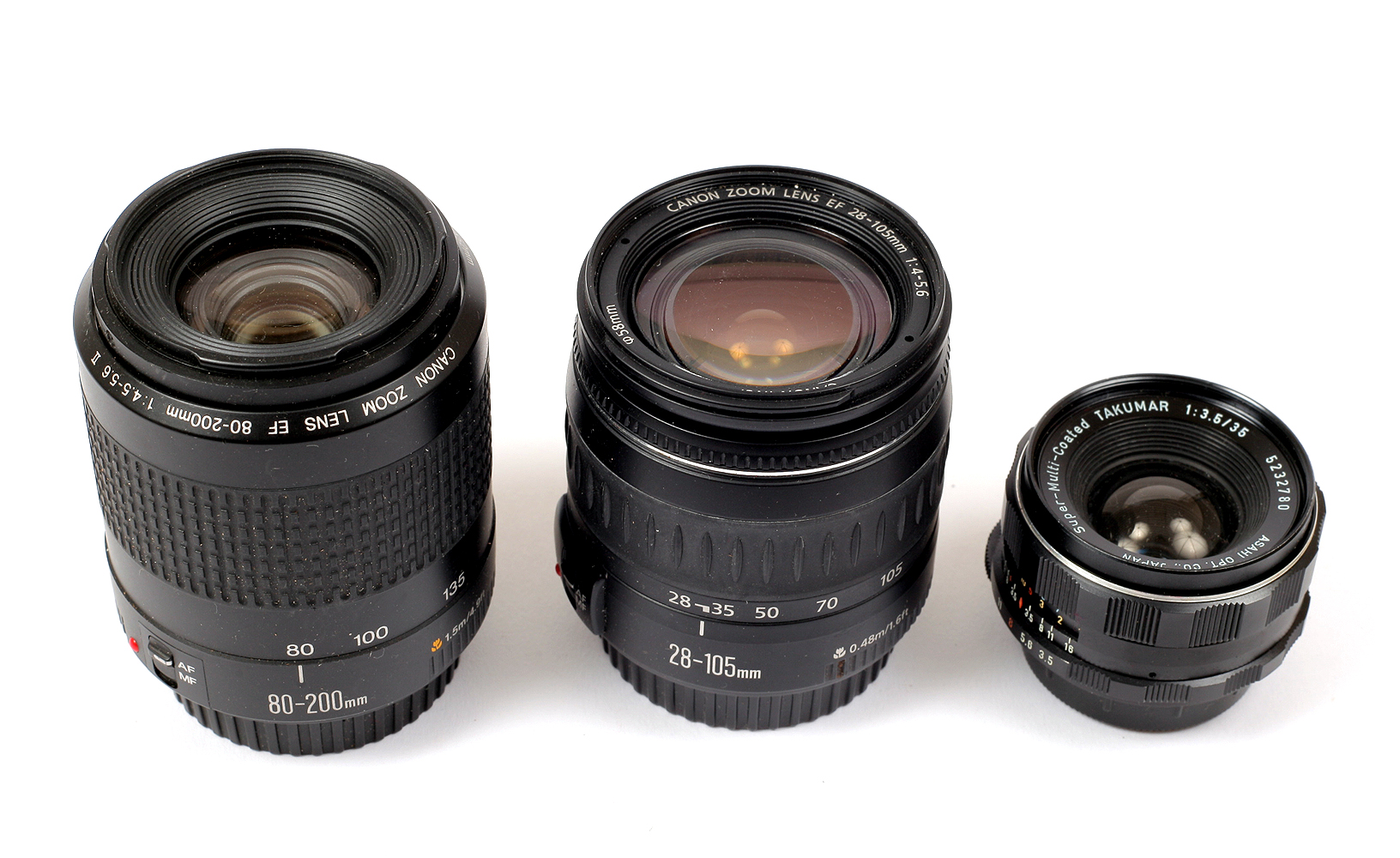 Lot 3 - Two Boxes of Miscellaneous Lenses. Including Canon 80-200mm, Canon 28-105mm and Takumar 35mm f3.