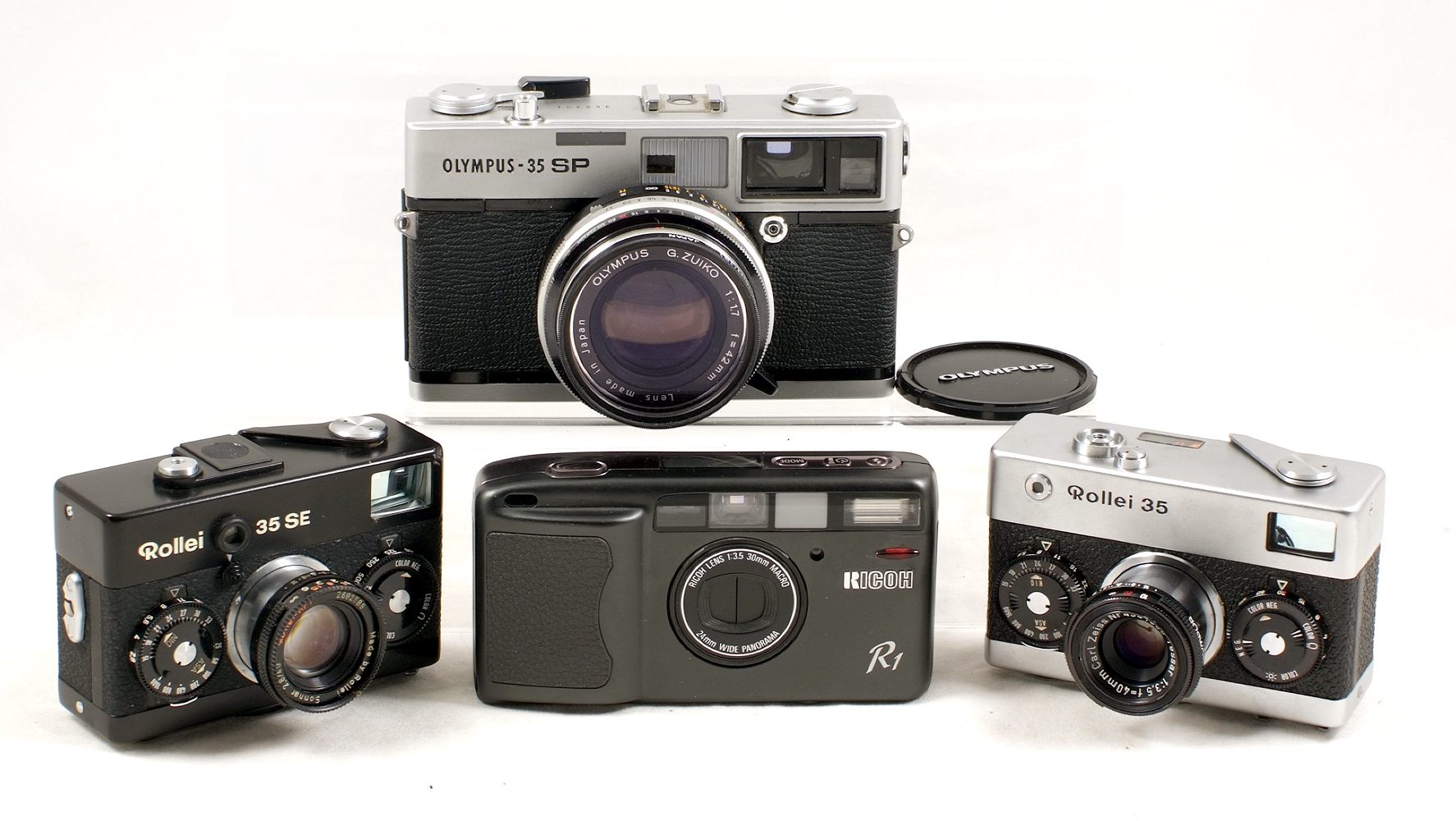 Lot 46 - Four Good Quality Compact Film Cameras. Comprising Ricoh R1 with 30mm f3.