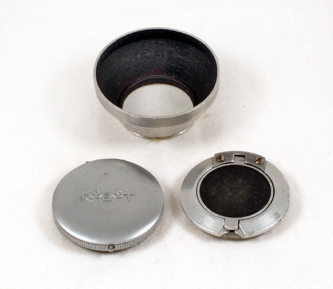 Lot 27A - Two Rare Robot Lens Caps, Flip-up Versions. (condition 5/6). Also an after-market lens hood.