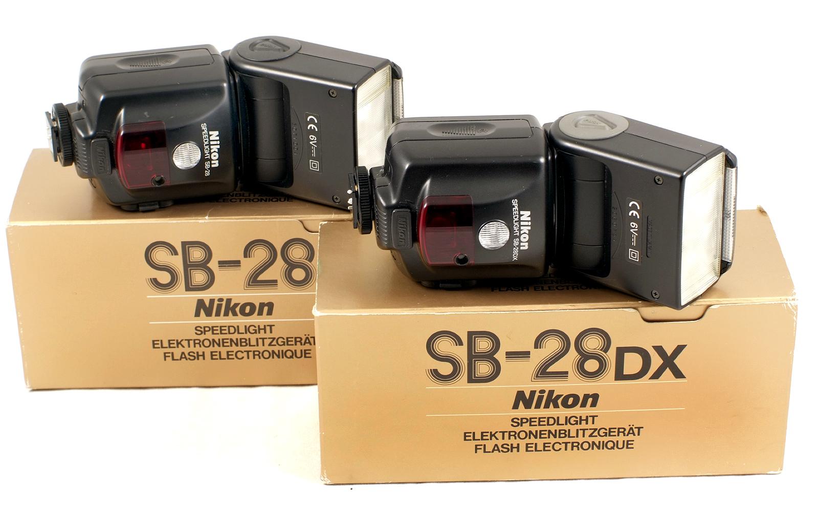 Lot 28 - Four Nikon SB Flash Units. Comprising SB12, SB23, SB28 and SB28DX (condition 5F).