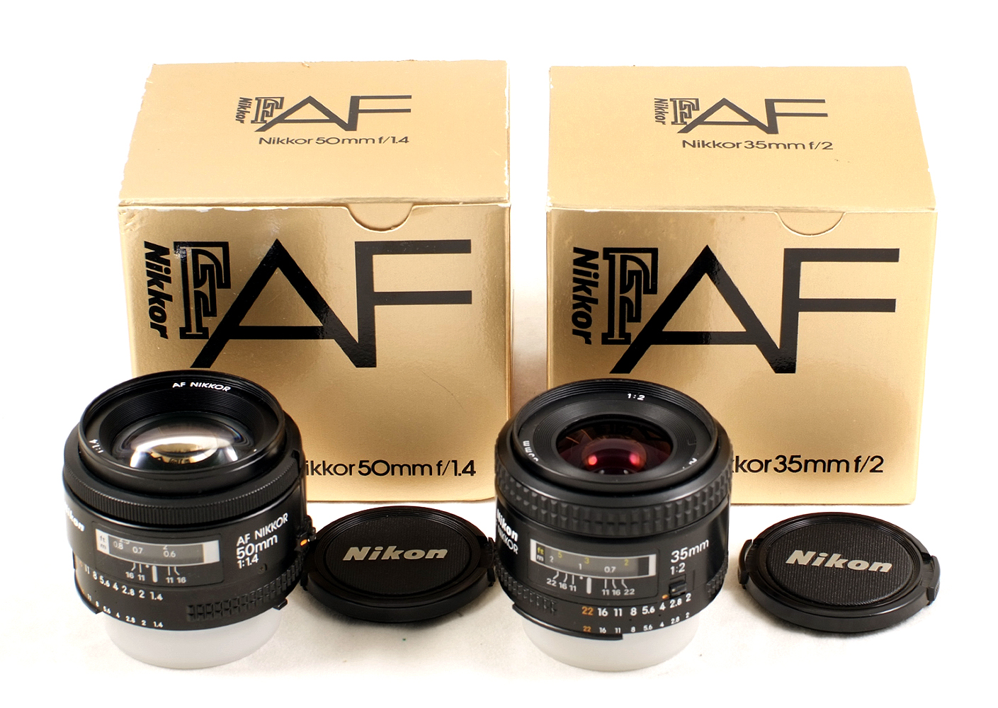 Lot 37 - Two Boxed Nikon Auto Focus Lenses. Nikkor 50mm f1.