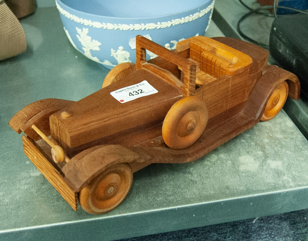 Lot 432 - A FRENCH WOODEN MODEL OF A TWO SEATER OPEN CAR