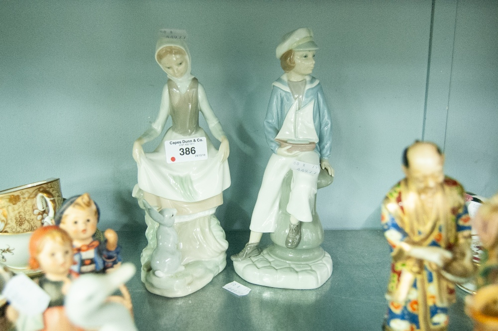 Lot 386 - TWO LLADRO FIGURES, BOY WITH TOY YACHT AND GIRL WITH RABBIT