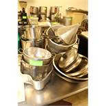 Group of colanders, stock pots, mixing bowls and lids