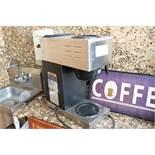 Bunn coffee brewer and coffee sign